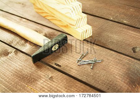 hammer nails on a wooden background home repair