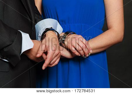 Couple problems love forever concept. Man and woman in handcuffs no freedom in relationship.