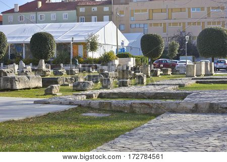 Zadar, Croatia - January 6, 2017: Ancient ruins of Roman forum in Green square.