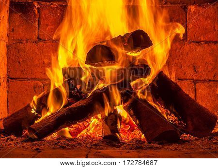 A fire burns in a fireplace, home.