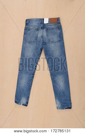 Blue Jeans- wooden background