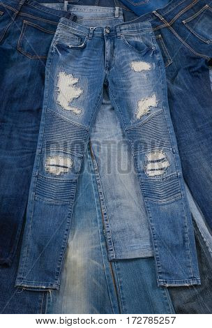 stacked of pile of jeans