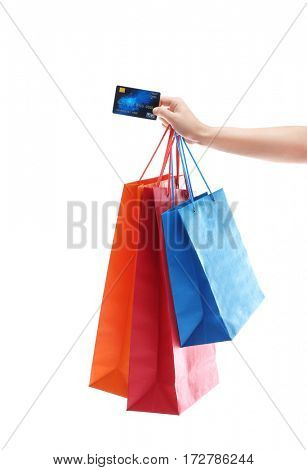 Woman holding shopping bags and credit card on white background