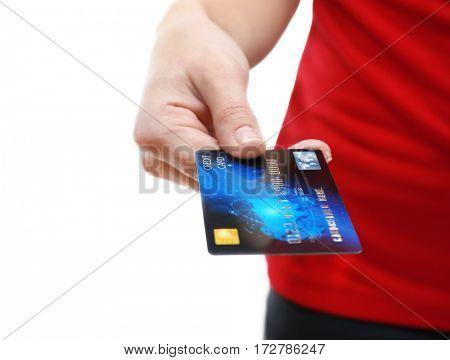 Woman holding credit card, closeup