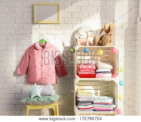 Clothes on shelf in kids room