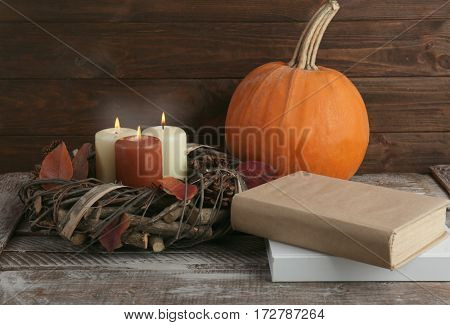 Beautiful autumn composition with pumpkin and books, closeup