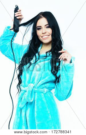 Sexy Girl Posing In Turquoise Velour Bathrobe With Straightener