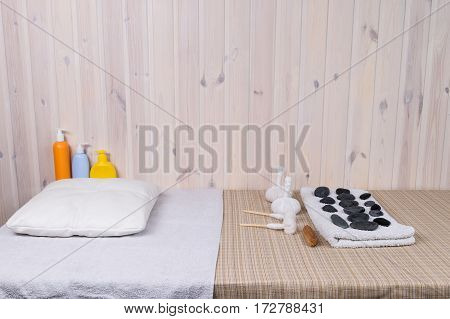 massage table with stones and bags for massage