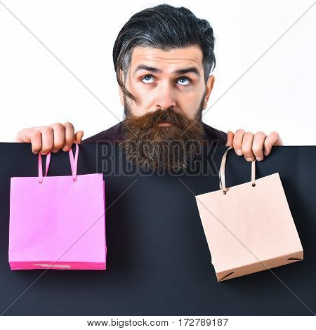 Bearded Brutal Caucasian Hipster Holding Colorful Package Or Bags