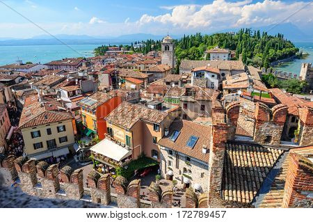Sirmione, province of Brescia, Lombardy, northern Italy - 15th August 2016: view to the old roofs of Sirmione town on lake Lago di Garda