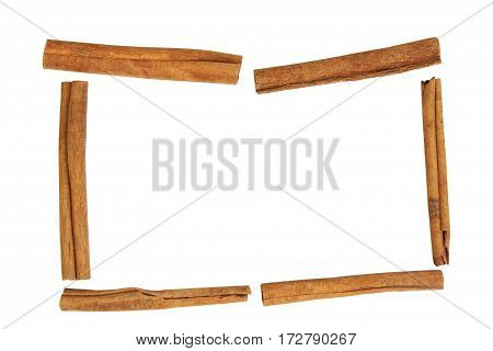 frame for cooking recipes from spices of cinnamon sticks isolated on white background
