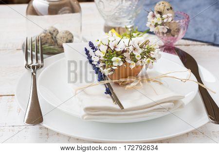 Romantic wedding table setting lavender white plates napkin flowers in eggshell Easter decoration outdoors kinfolk