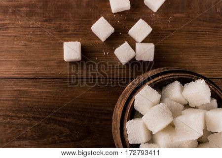 Diabetes. A lot of sugar cubes in jar.