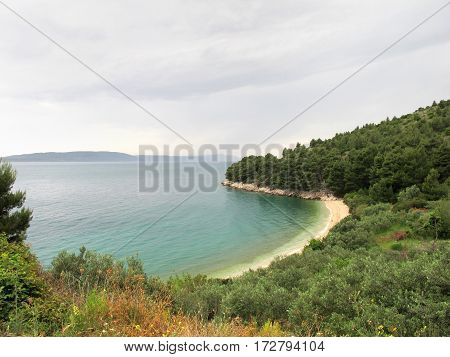 paradisiac beach isolated in the forest of Croatia