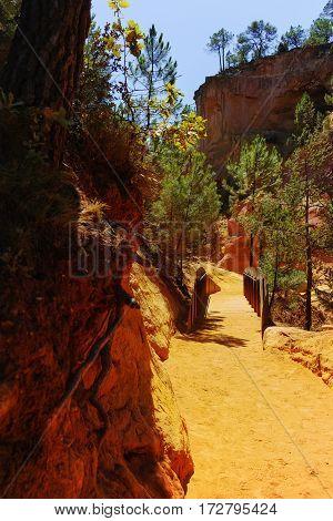 Oragne ochre picturesque hills. Roussillon village, Provence France. Preserve natural dye production - ocher.