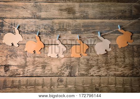 Easter garland on wooden background