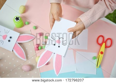 Little girl holding handmade Easter gift box