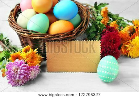 Colorful Easter eggs on wooden table