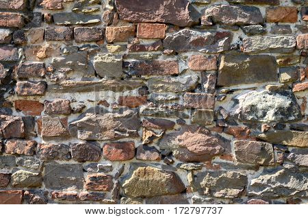 Background with the old gray-brown brick wall