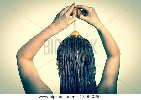 Woman Applying Egg Conditioner On Her Hair