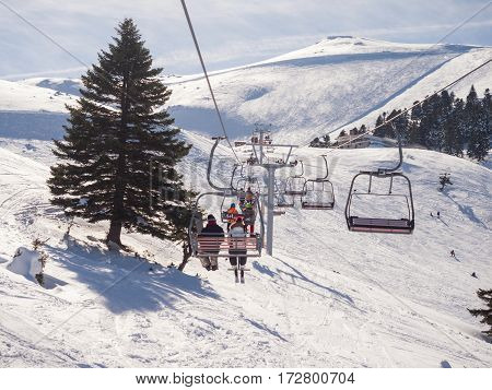 Kalavrita Greece - January 28 2017: View from the lift of Kalavrita ski center with people on the slopes in a sunny day