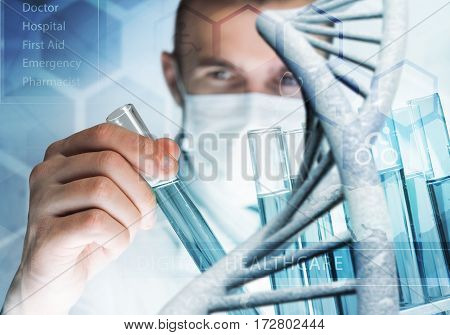 Handsome scientist making research over dna molecule structure
