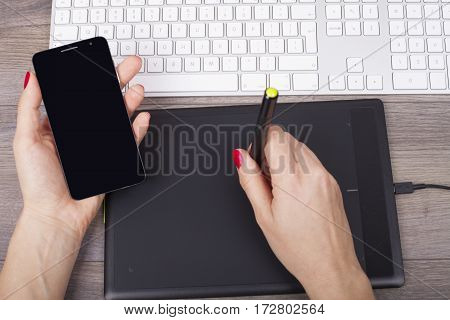 The Graphic Designer Uses A Digital Tablet