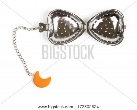 Metal tea strainer with heart shape on chain isolated on white background