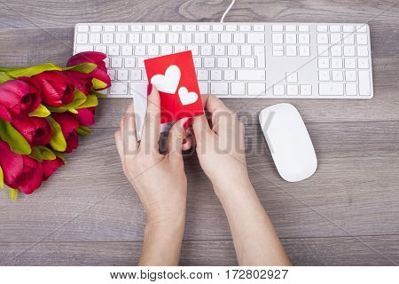 Closeup Of Female Hands Holding Love Greeting Card On The Desk