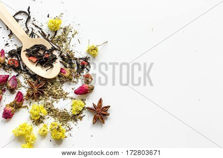 Virious kinds of herbs in wooden spoon on white table background top view mockup