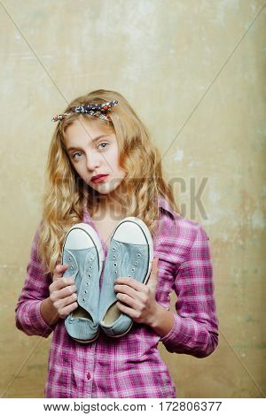 Pretty Girl With Blue Fashion Sneakers In Hands