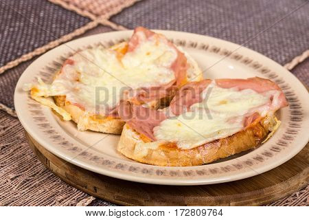 Ham And Melting Cheese Sandwich On The Plate