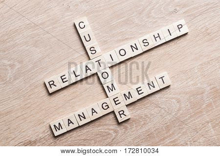 Words of business marketing collected in crossword with wooden cubes. Customer Relationship Management.