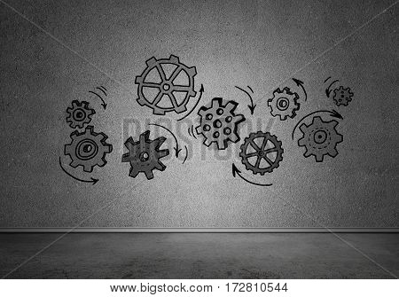 Gears and hand drawn mechanisms on gray wall.