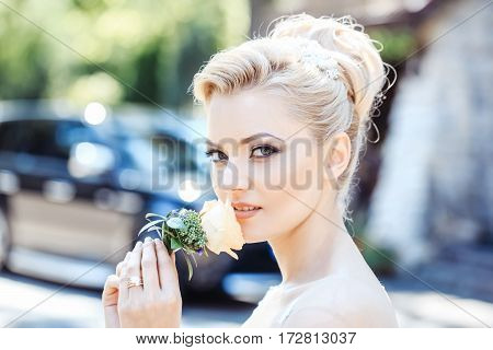 Pretty Girl Smells Flower