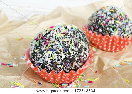 Tasty Colorful coconut cupcake with chocolate, copy space