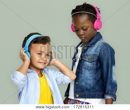 Kids enjoying listening to music with headphones