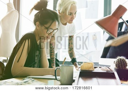 Fashion designer brainstorming and sharing ideas