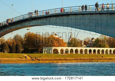 Architecture landscape of Veliky Novgorod, Russia - Yaroslav's Courtyard and footbridge across Volkhov river in Veliky Novgorod Russia