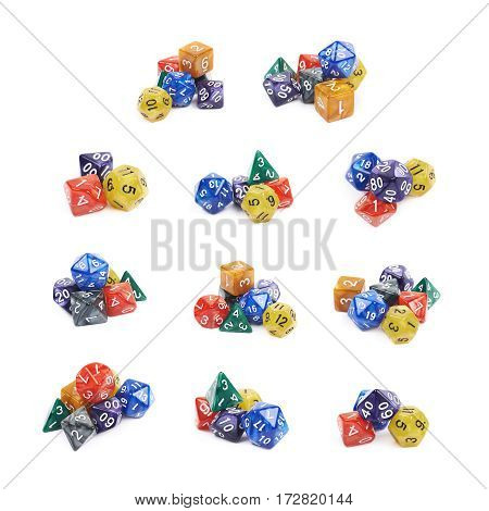 Pile of colorful roleplaying polyhedral dices isolated over the white background, set of multiple different foreshortenings