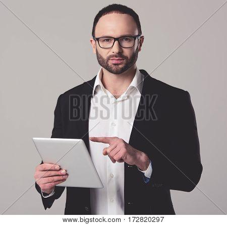Handsome Businessman With Gadget