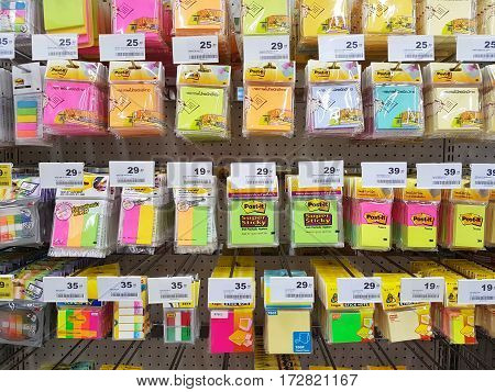 CHIANG RAI THAILAND - FEBRUARY 15 : various brand of colorful stick note in packaging for sale on supermarket stand or shelf on February 15 2017 in Chiang rai Thailand.