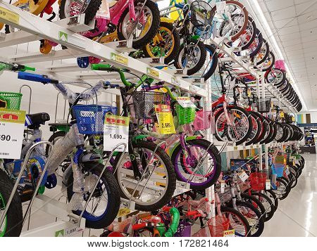 CHIANG RAI THAILAND - FEBRUARY 15 : various brand of kids bicycle in packaging for sale on supermarket stand or shelf on February 15 2017 in Chiang rai Thailand.