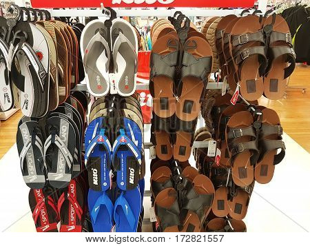 CHIANG RAI THAILAND - FEBRUARY 15 : various brand of toe post sandals for sale on supermarket stand or shelf on February 15 2017 in Chiang rai Thailand.