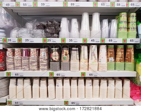 CHIANG RAI THAILAND - FEBRUARY 15 : various brand of plastic and paper glasses in packaging for sale on supermarket stand or shelf on February 15 2017 in Chiang rai Thailand.