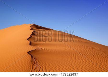 Sand dunes at sunset  in the Sahara Desert, Merzouga, Morocco
