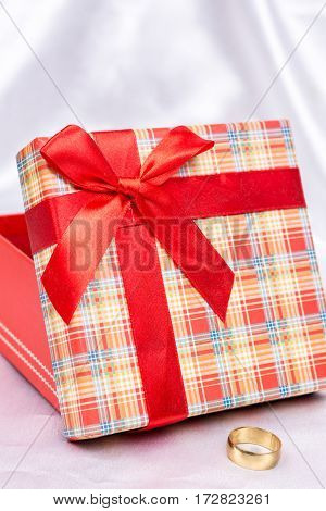 Gift Box With Red Bow And Golden Wedding Ring