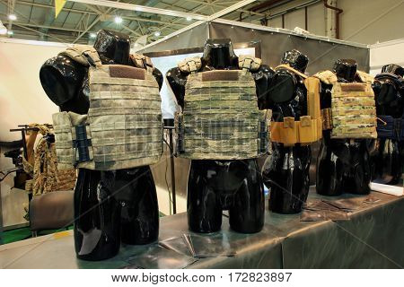 Samples of bulletproof vests on mannequins at special exhibition