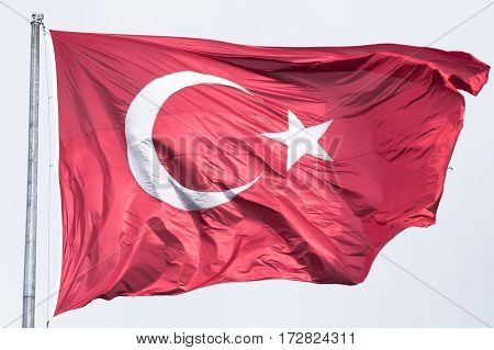 Turkish flag floating in the air in a windy environment