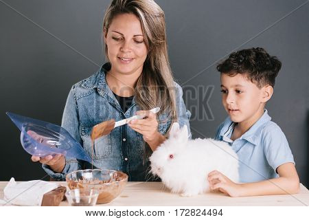 Mom And Son Making Homemade Easter Eggs